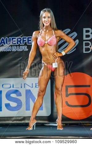 MOSCOW, RUSSIA - NOVEMBER 21, 2015: Daria Goloshumova participates in Bodybuilding Champions Cup during SN Pro Expo Forum 2015 on November 21, 2015 in Moscow, Russia