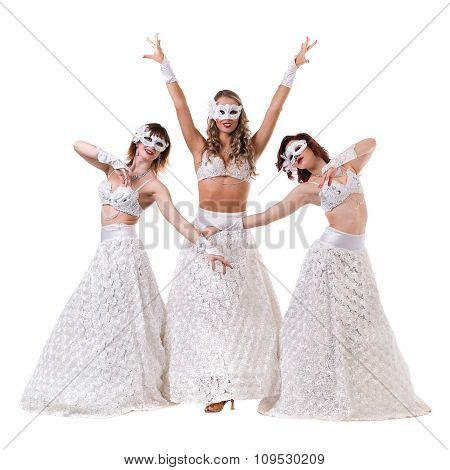 Three carnival dancer women wearing a mask dancing, isolated on white