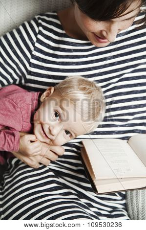 Child with mother are reading a book
