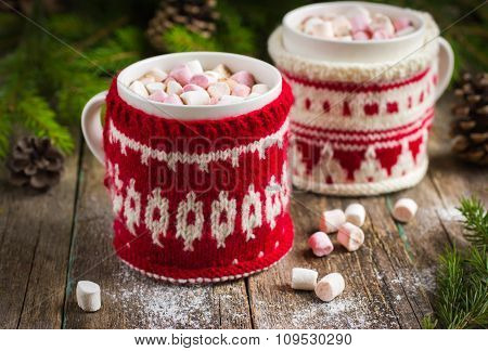 Mugs With Hot Chocolate And Murshmallow, Wrapped In A Winter Knitted Cup-holders