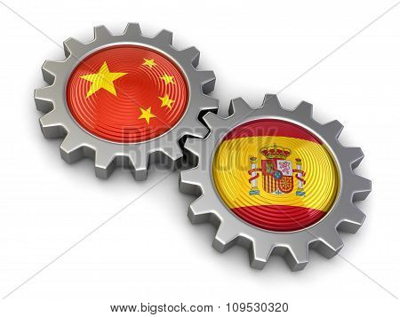 Chinese and Spanish flags on a gears (clipping path included)