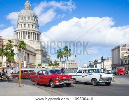 HAVANA,CUBA - NOVEMBER 12, 2015 : Street scene with old american cars near the Capitol of Havana
