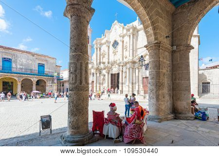 HAVANA,CUBA - NOVEMBER 12, 2015 : Tourists and cubans at the plaza next to the Cathedral of Havana