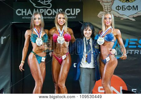 MOSCOW, RUSSIA - NOVEMBER 21, 2015: Winners pose in Bodybuilding Champions Cup during SN Pro Expo Forum 2015 on November 21, 2015 in Moscow, Russia