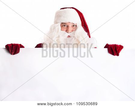 Santa Claus Pointing In White Blank Sign
