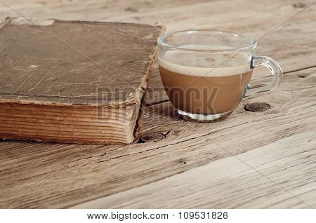 Cup Of Coffee With An Old Book