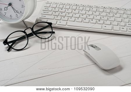 White Keyboard, Computer Mouse And Stylish Glasses
