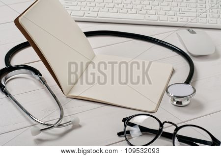 Open Notebook With Blank Pages With Stethoscope