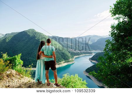 Lovely Couple Relax On Peak Of Mountains