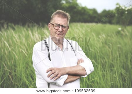 Man Field Alone Think Looking Camera Concept