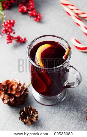 Mulled red wine with spices, orange slices
