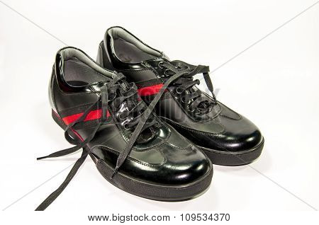 Black men shoes with red stripe