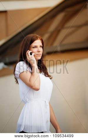 Young Lady Talking On Mobile Phone