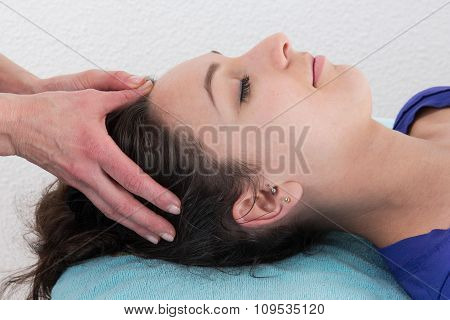 Young Bright Woman Receiving A Head Massage In A Spa Center