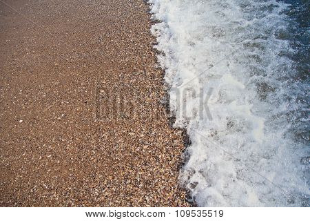 Oncoming Waves On A Beach Sand. Backgrounds And Textures