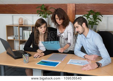 Business And Office Concept - Business Team Looking At Reporting
