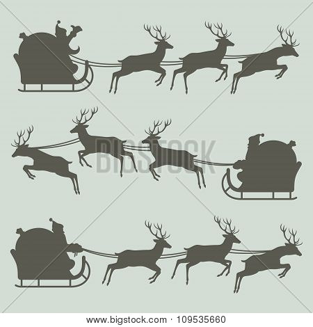 Silhouettes of Santa Claus on his sleigh