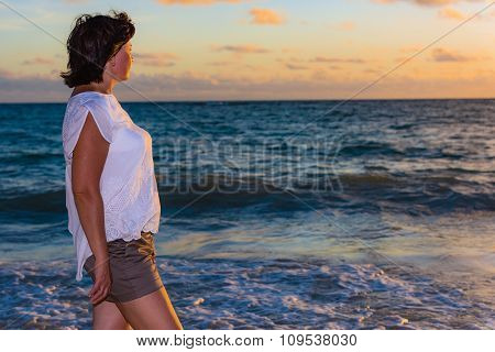 Brunette Woman At Sunrise