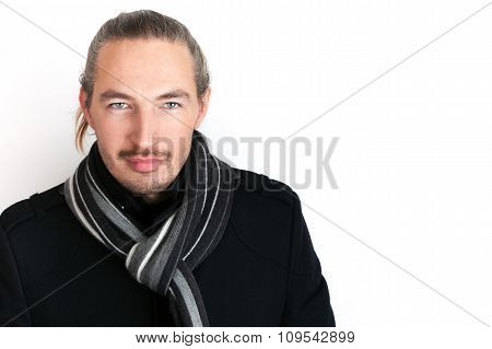 Serious Young Asian Man In Black Coat