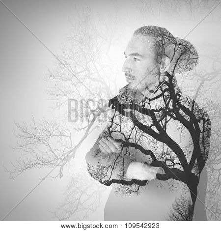 Asian Man Combined With Bare Tree Landscape