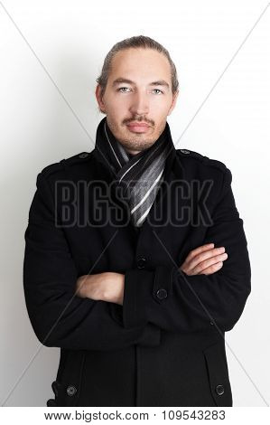 Asian Man In Black Coat And Woolen Scarf