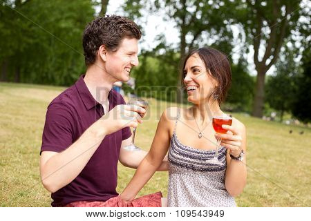 couple drinking in the park