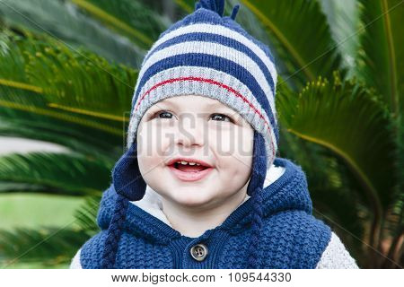 little happy boy one year old outdoors in spring or autumn portrait