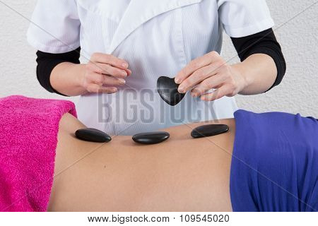 Stone Massage For Young Woman At Beauty Spa Salon.