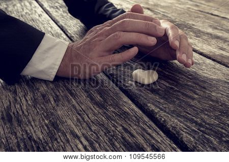 Male Hands Making Protective Sheltering Gesture Over A Marble Made Heart