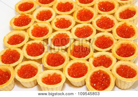 Tartlets with salmon caviar, fish a delicacy.