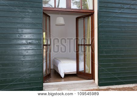 Open Window With Green Frame And Brown Glass,