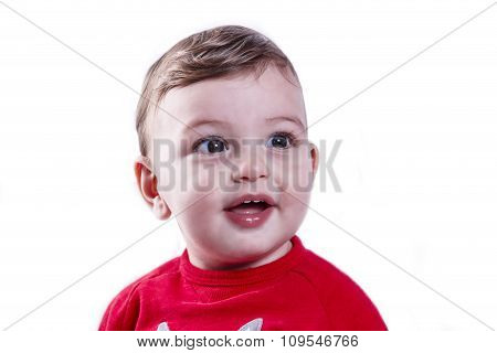 little happy boy one year old on a white background portrait