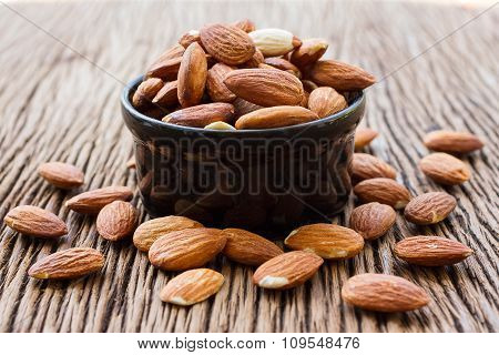 Almonds In Black Bowl On Almonds Background