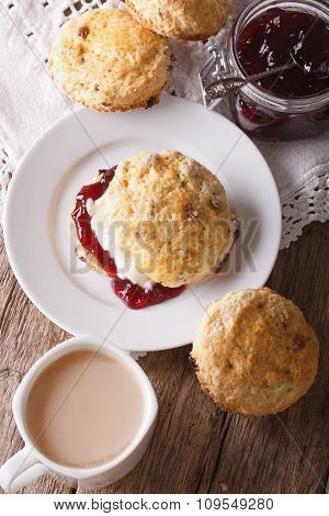 Delicious English Scones With Jam And Tea With Milk Close-up. Vertical