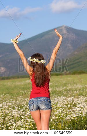 Girl on camomile field