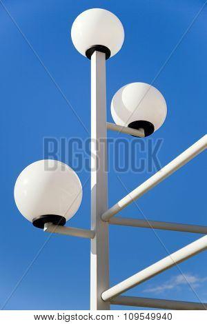 Street lanterns  against the blue sky