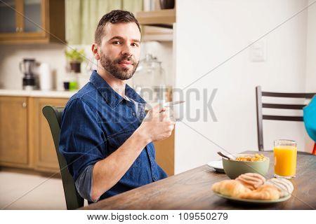 Young Man Enjoying Breakfast At Home