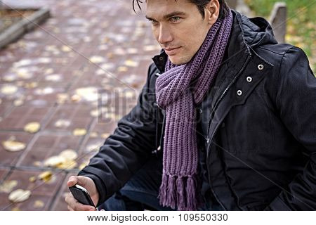 Handsome Man With Scarf Holding Smartphone