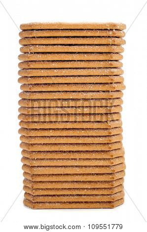a stack of appetizing cinnamon cookies on a white background