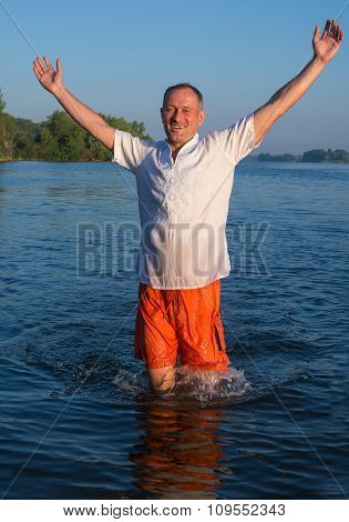 Happy Man Running In Water