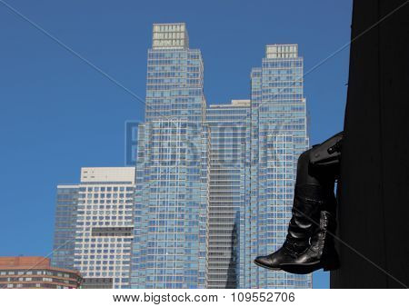 Resting Black Leather Boots With Skyscraper Background