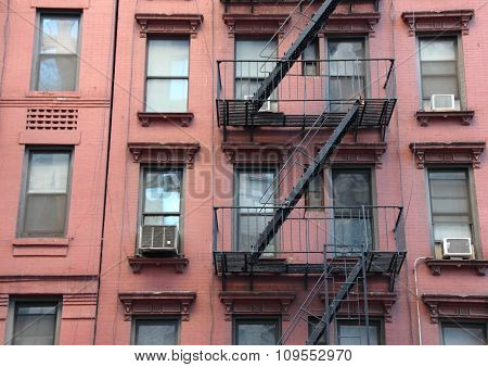 Fire Escape Steel Ladder On Urban Red House Facade
