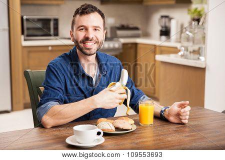 Happy Guy Eating A Banana