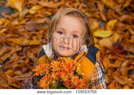 Autumn portrait of adorable little blond boy