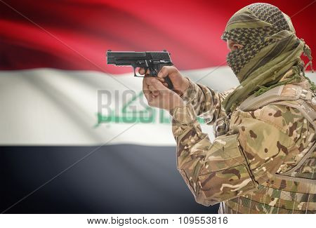 Male With Gun In Hand And National Flag On Background - Iraq