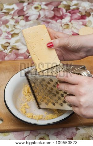 Woman Rubs Cheese