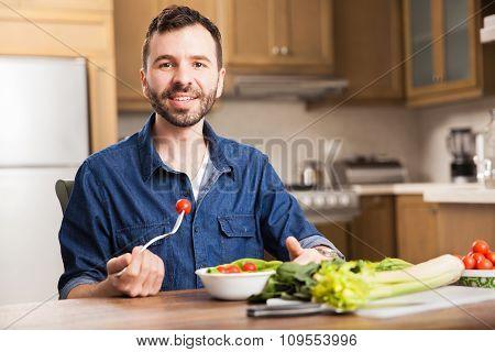 Man Eating A Salad At Home