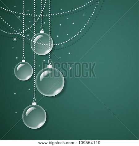 Transparent glass decorations on green background