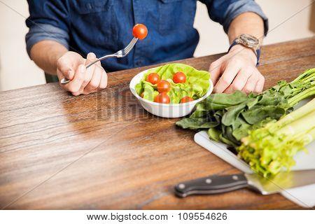 Man Eating A Salad Up Close
