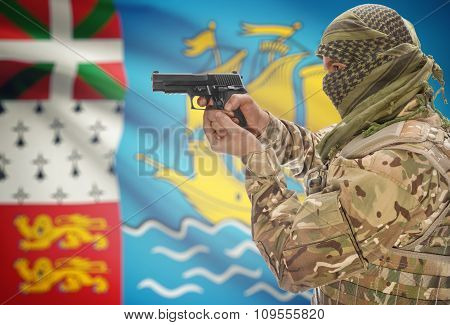 Male With Gun In Hand And National Flag On Background - Saint Pierre And Miquelon